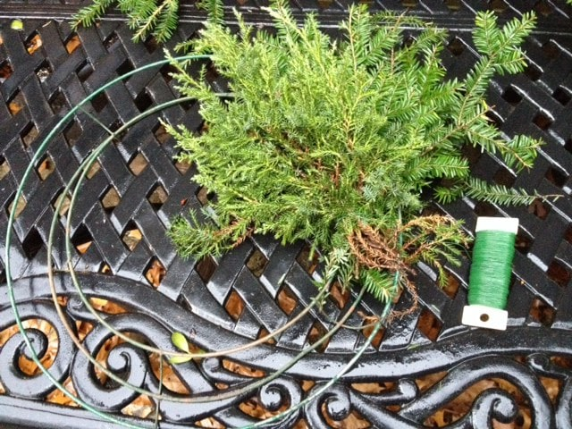 Attaching greenery to wire wreath base
