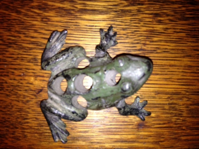Antique cast flower frog in shape of a frog