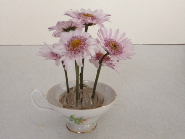 using flower frog in teacup ~ flower frogs ~ gardenmatter.com