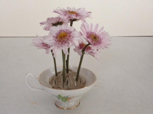 using flower frog in teacup ~ flower frogs ~ gardenmatter.com
