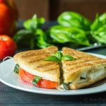 Caprese panini sandwich with tomatoes, basil and fresh mozzerella