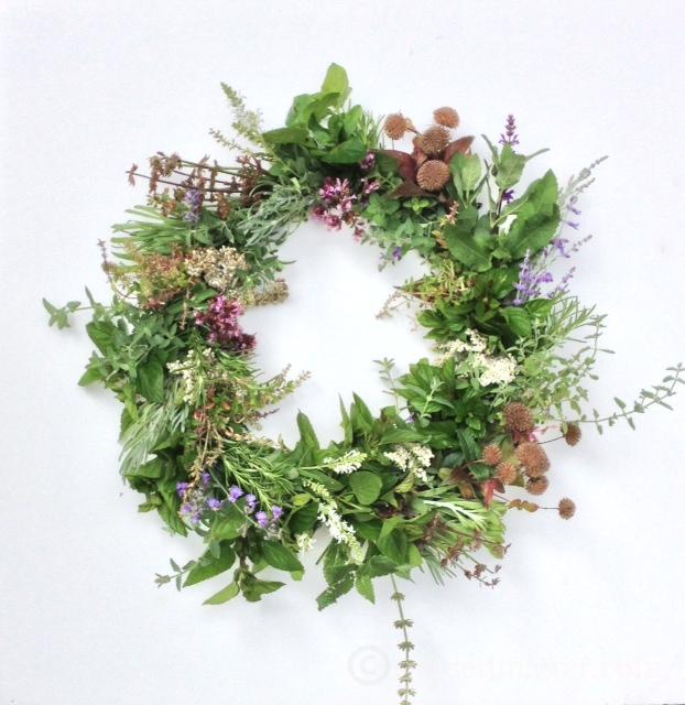 How to use herbs and other flowers to make this beautiful easy to create wreath.
