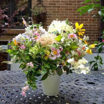 Cottage garden flowers in white vase