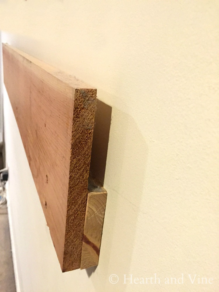 Cleat for hanging door headboard