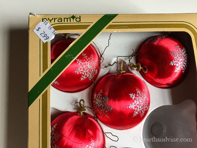 Box of red satin Goodwill ornaments