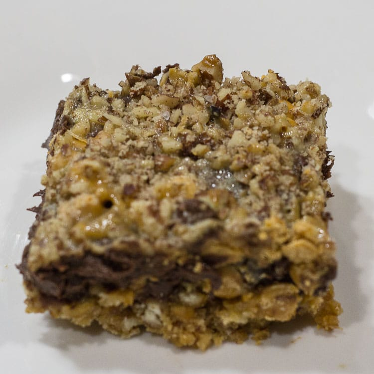 Chocolate caramel bars with pretzel crust.