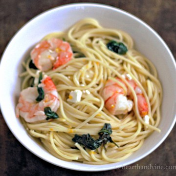 Bowl of Meyer lemon pasta with spinach and feta cheese