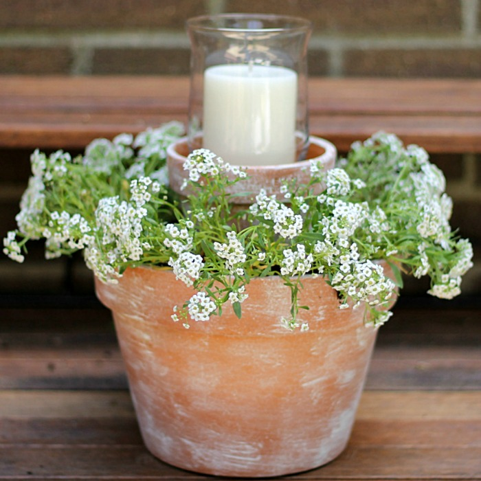 Flower pot centerpiece with candle