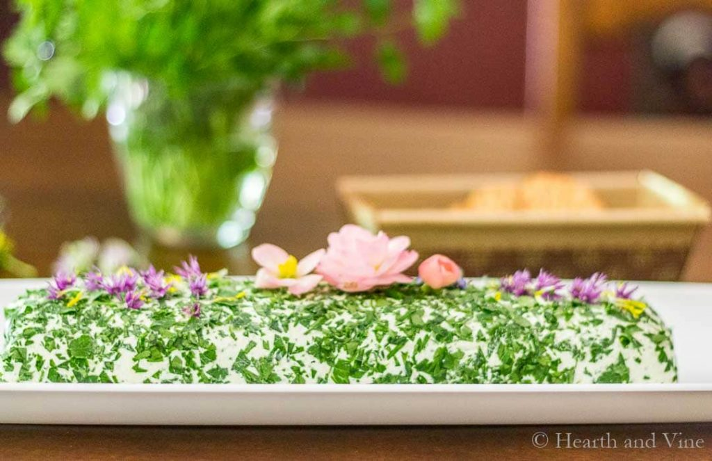 Herbed cheese spread with edible flowers