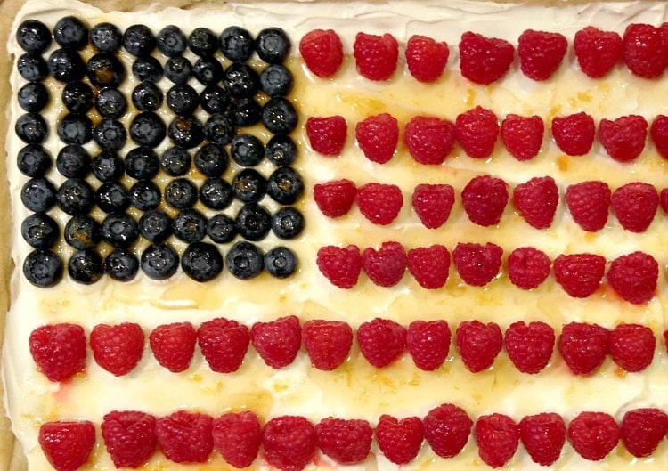 Flag fruit tart with blueberries and raspberries.