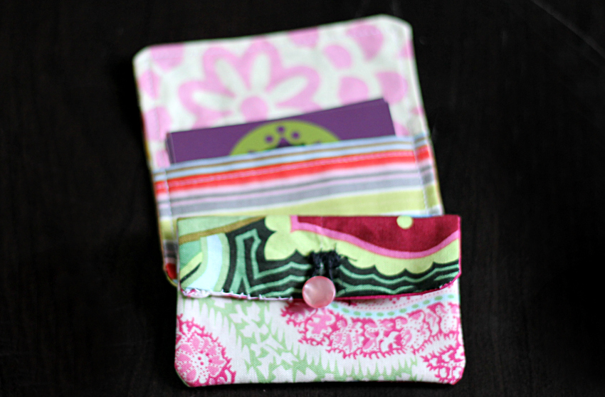 Fabric card holder with a button closure