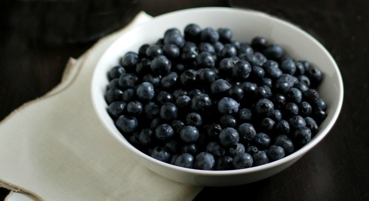 Bowl of blueberries for flag fruit tart