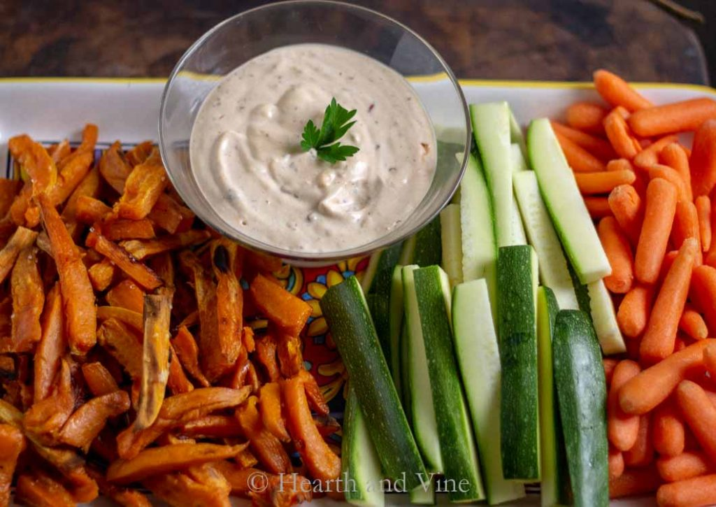Chipolte aioli on a tray of fries and veggies