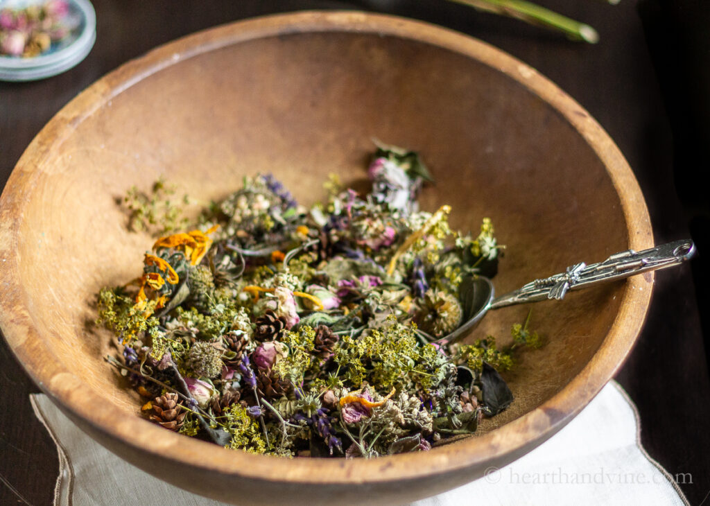 Large wooden bowl of dried flower potpourri