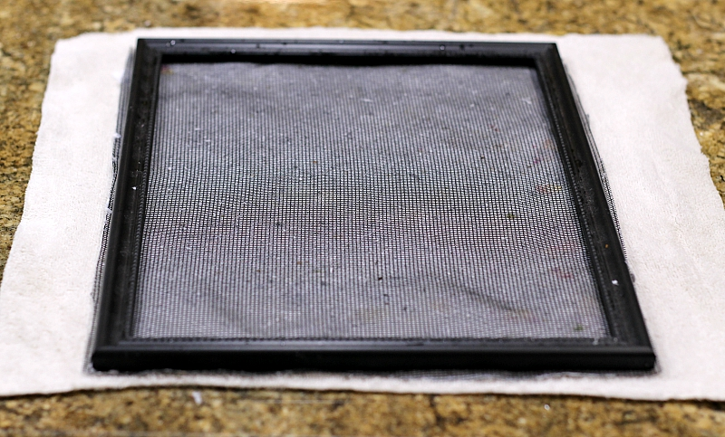 Handmade paper frame with pulp on cloth