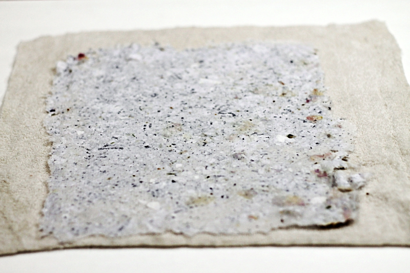 Fresh handmade paper pulp drying on a cloth