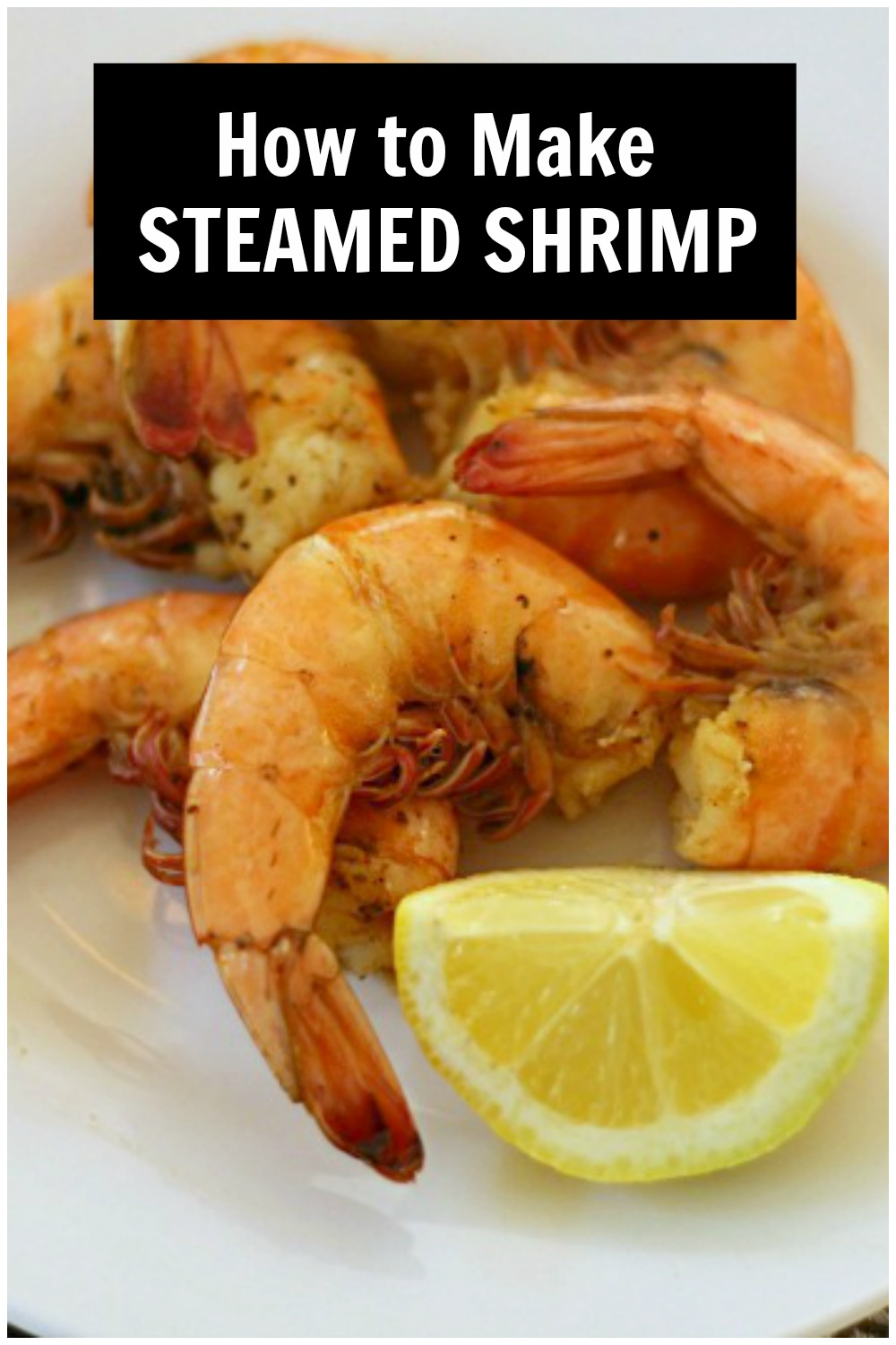 Steamed shrimp and lemon wedge