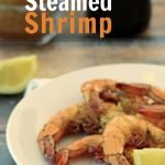 Plate of shrimp that has been steamed in beer and old bay seasoning.