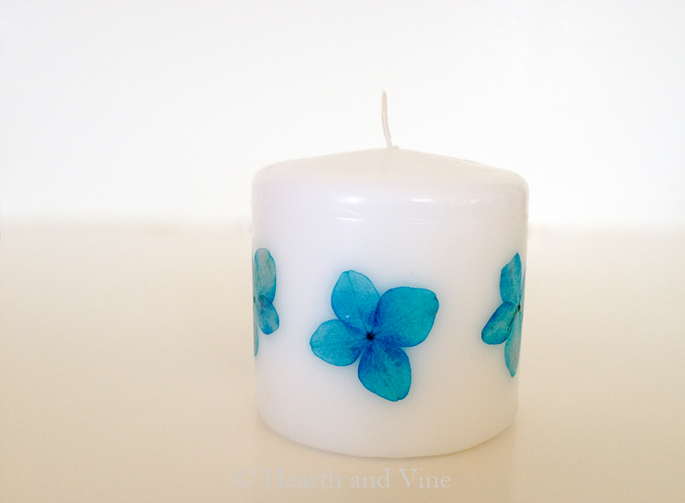 Small pressed flower candle with blue flowers