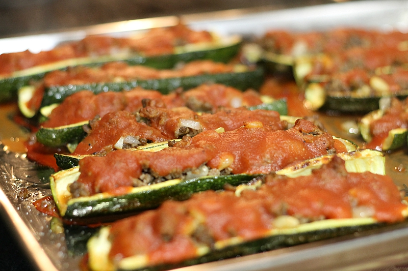 Half zucchini stuffed on tray
