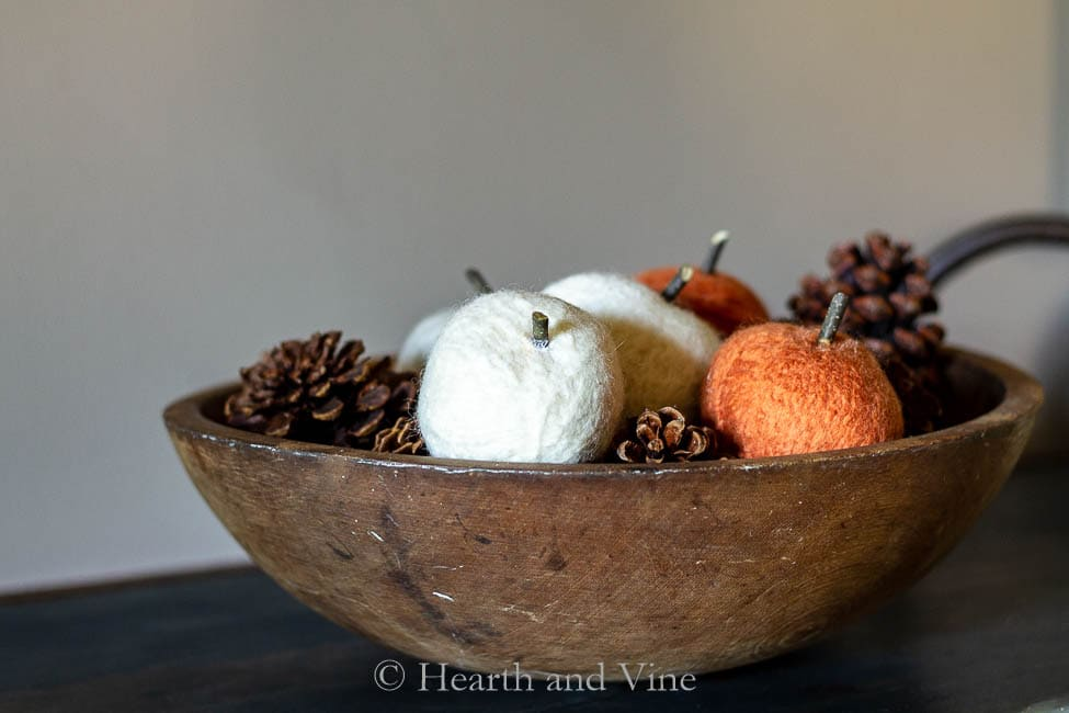 Dryer ball pumpkins in bowl