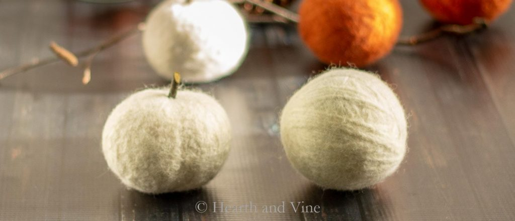 Dryer ball pumpkin over tennis ball