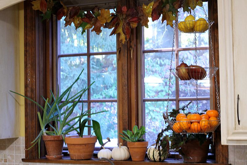 Natural fall leaf garland hanging in kitchen window