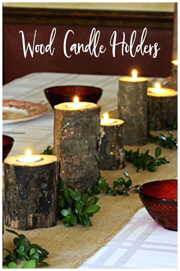 Table decorated with rustic wood candle holders