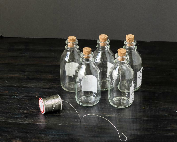 Glass bottles and wire for bottle garland