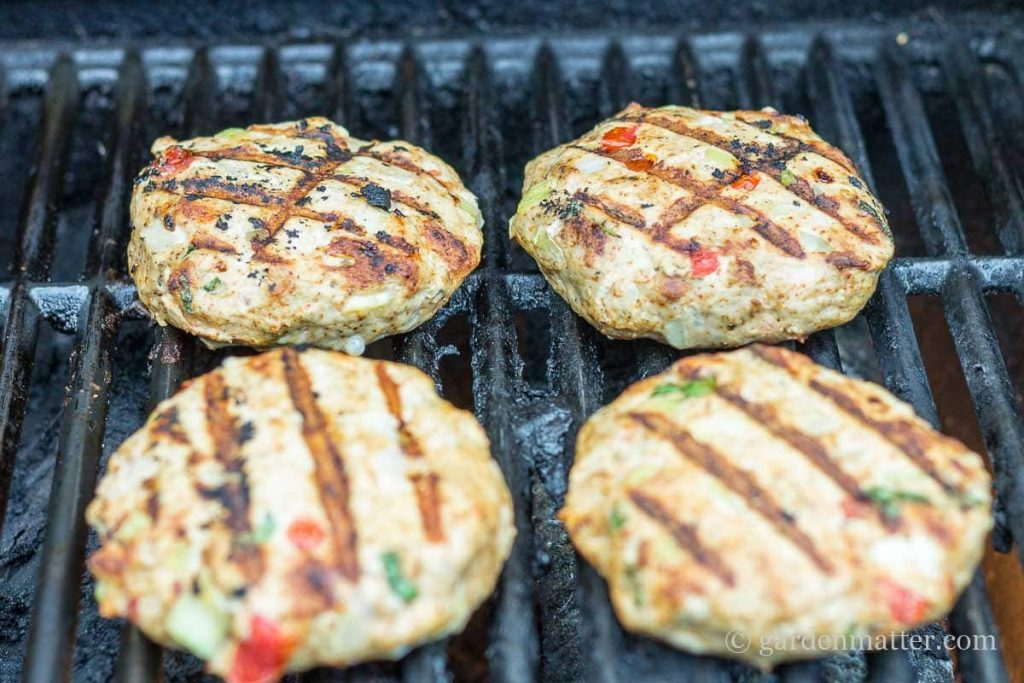 Cooked Southwest Turkey Burgers on grill