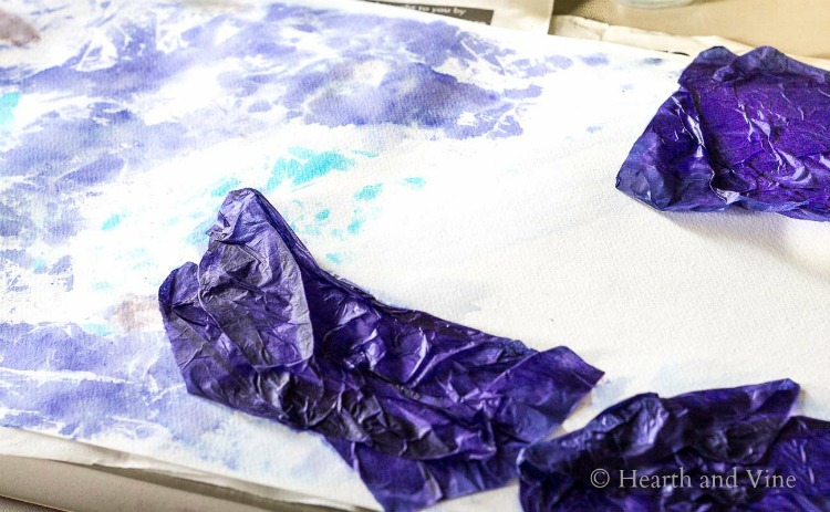 Painting the background with tissue paper