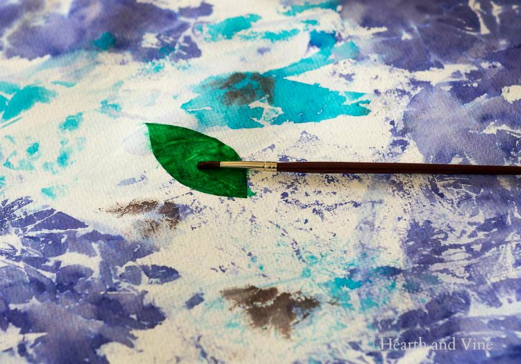 Painting a leaf with tissue paper
