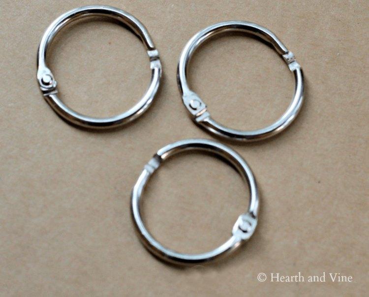 Three silver binder rings