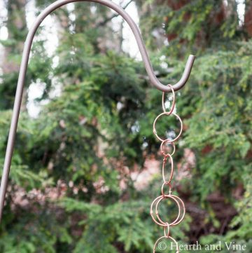 Copper rain chain on a shepherd's hook