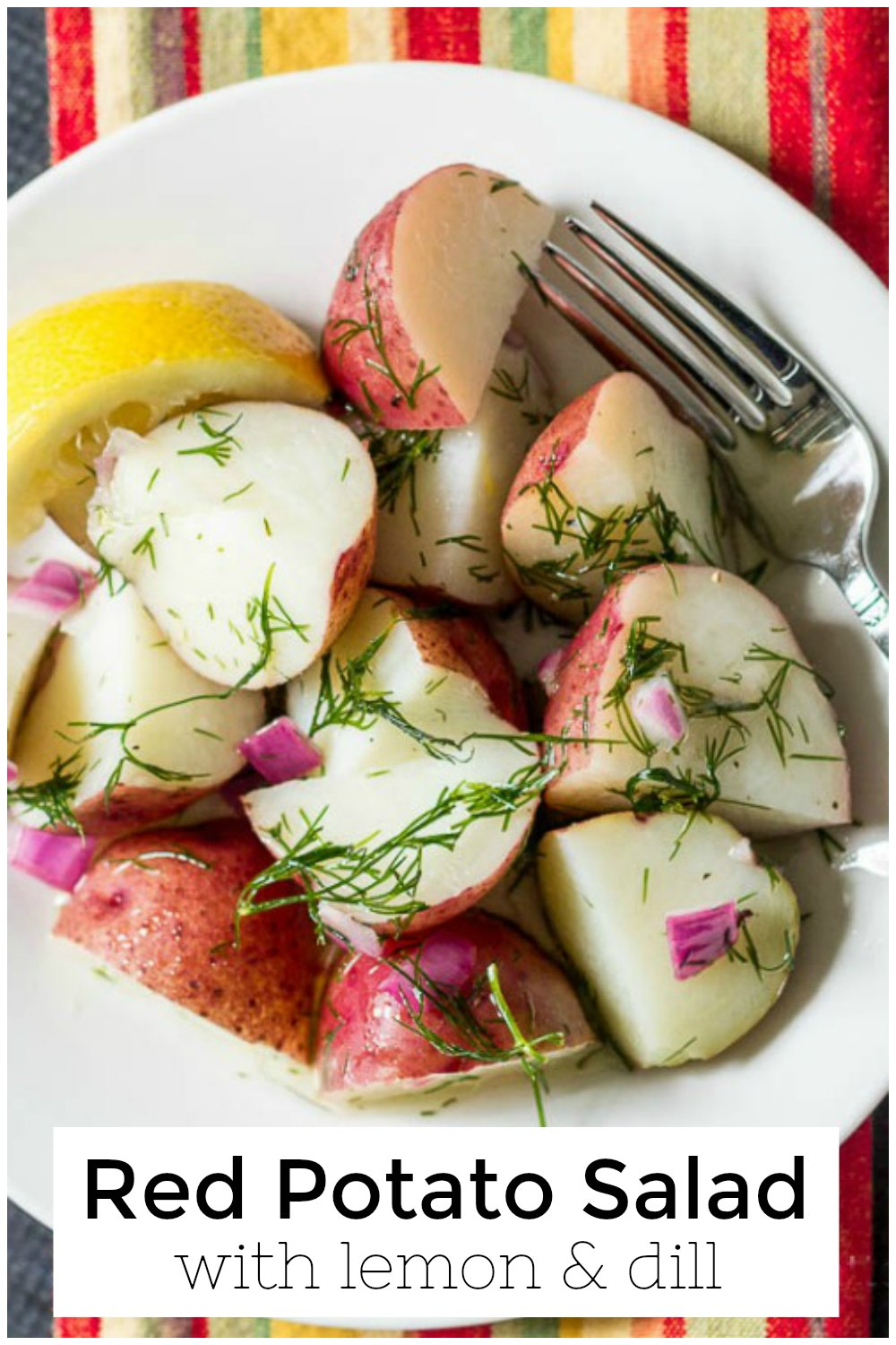 Red potato salad on striped napkin with text overlay