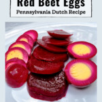 Pickled red beets sliced and pickled red beet eggs sliced on a plate.