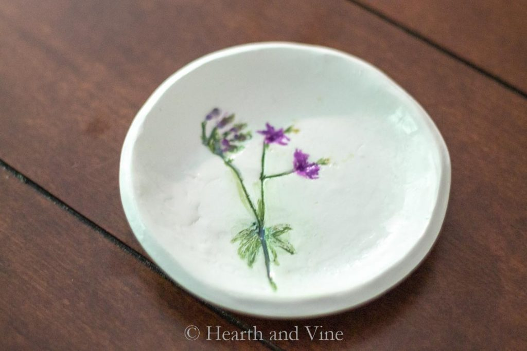 Jewelry dish with magenta flower