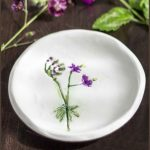 Geranium flower pressed into clay to make a small decorative jewelry dish.