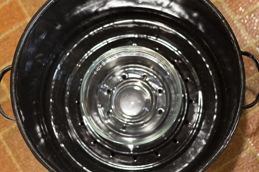 Glass bowl in upper pot.