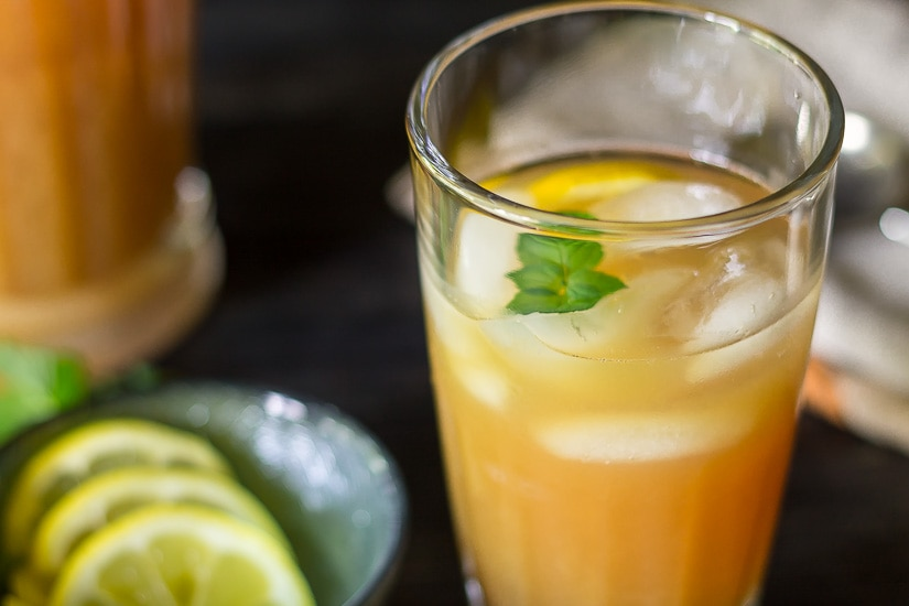 Glass of Fruit Tea punch with lemon and mint