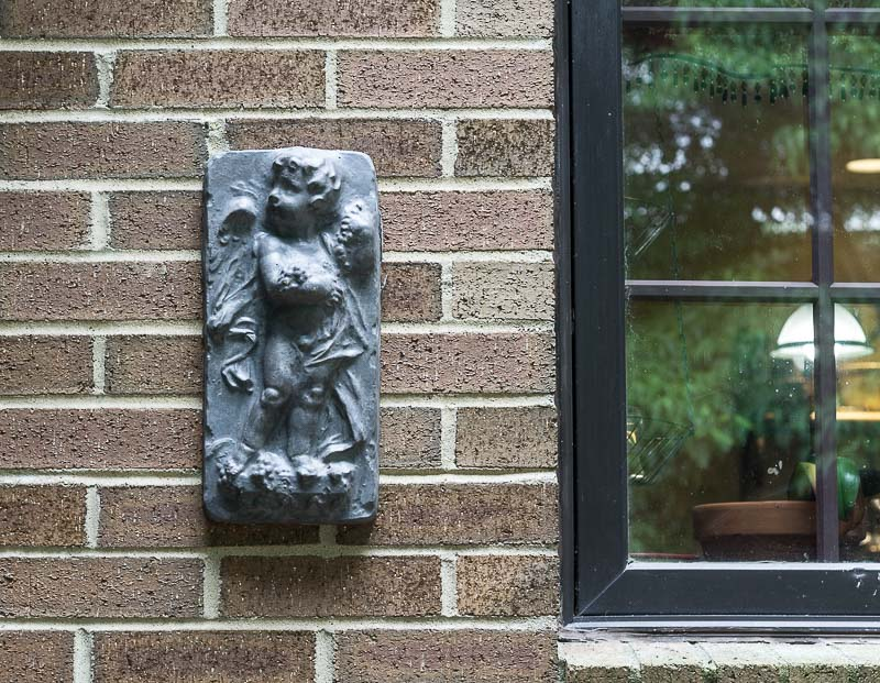 Painted Concrete Cherub Plaque ~ faux lead garden ornament ~ gardenmatter.com