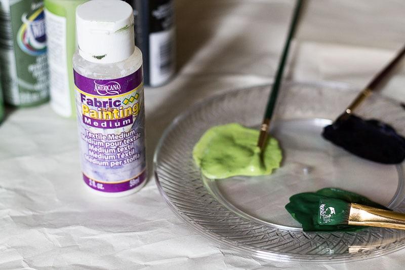 Fabric Medium and three shades of green paint.