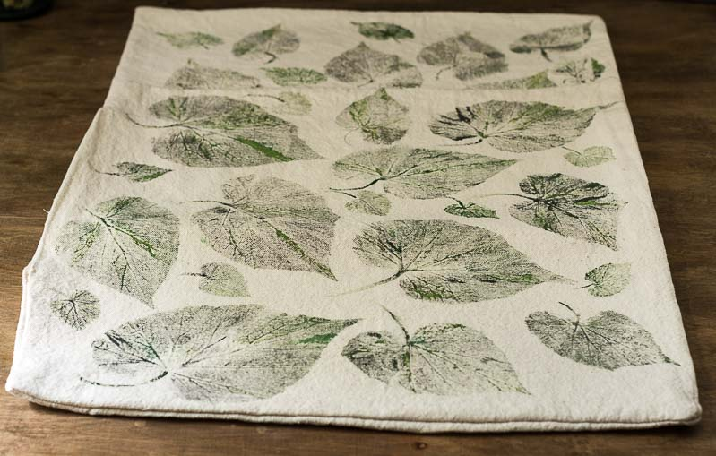 Leaf printed drop cloth pillow cover.