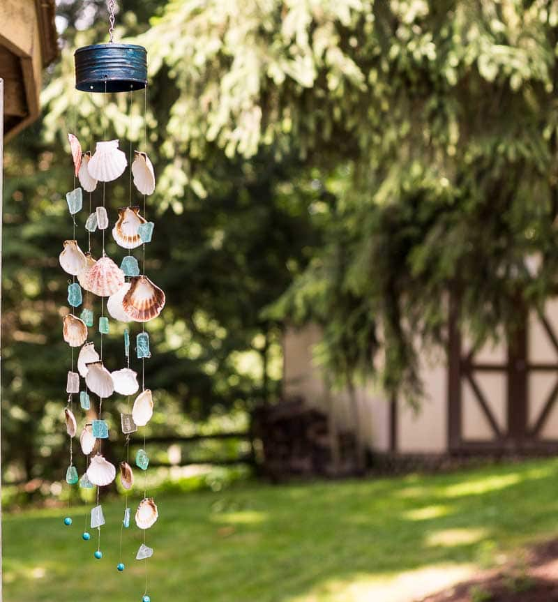 A handmade Seashell & Seaglass Wind Chime hanging outside