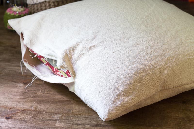 Open end of pillow case made from drop cloth material.