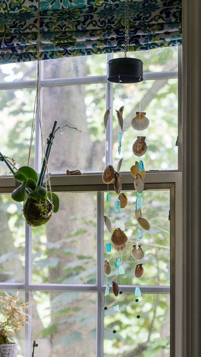 DIY wind chime completed and hanging in a window.