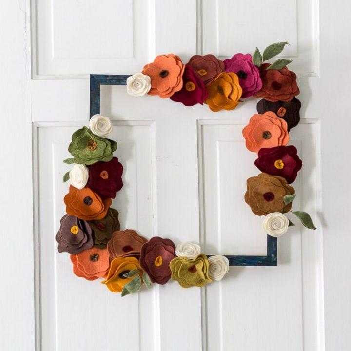 felt flower wreath on door