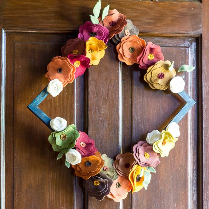 Felt Flower Wreath On wooden door hung like a diamond