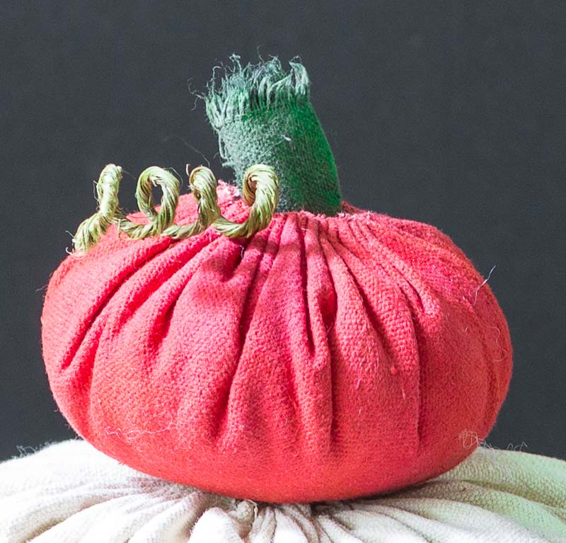 Small red fabric pumpkin with stem