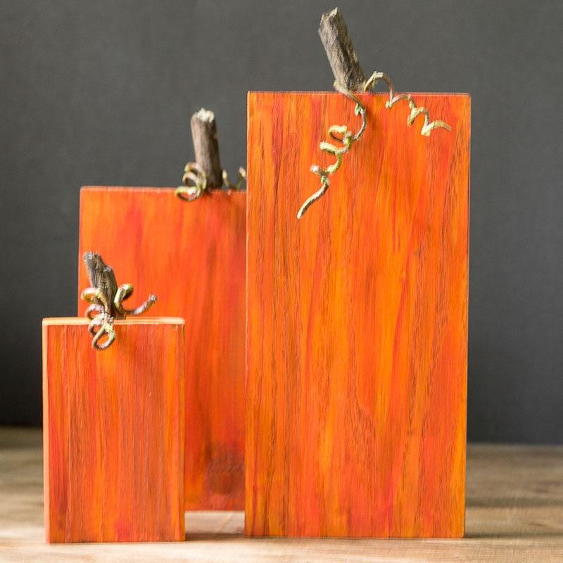 three-rustic-wooden-pumpkins